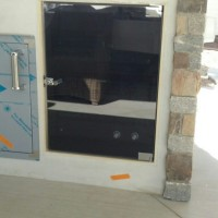 Custom Designed Gray-lite Cabinet Glass with Pivot Hinges and Keyed Lock for Outdoor Electronics