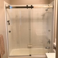Frameless Dual Slider Shower over Tub