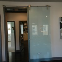 Glass Barn Door in Acid Etched Glass and Chrome Hardware