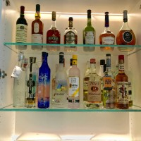 1/2 Starfire Glass Shelves on a backlit bar area